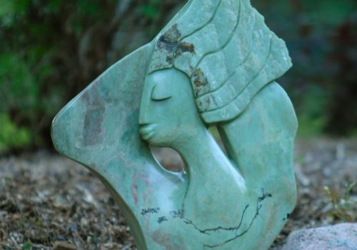 Zimbabwean Shona sculpture of woman, hands in hair suggesting freedom, made by Walter Mariga