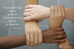 "African proverb quote - ""If you want to go faster, go alone. If you want to go farther, go together"" on image of four multicultural hands clasping"