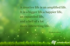 Quote on background of light beams and green. A creative life is an amplified life...Elizabeth Gilbert