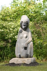 stone sculpture that looks like a baboon with human characteristics by father of Shona sculpture, Joram Mariga