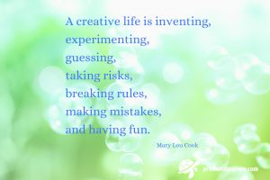 Quote on green nature background with bubbles. A creative life is inventing, experimenting...Mary Lou Cook