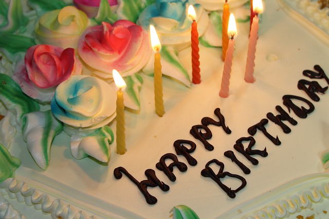 lit candles on a birthday cake, one of the benefits of burning candles
