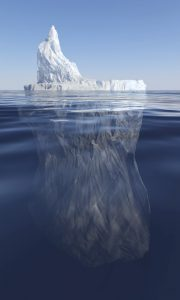 realistic photo of iceberg showing 20% above water, rest underwater to represent immunity to change