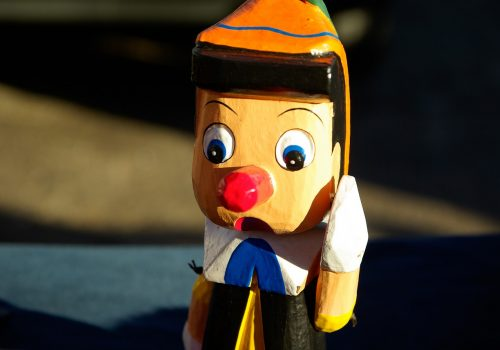 pinocchio puppet to demonstrate illusion of truth effect