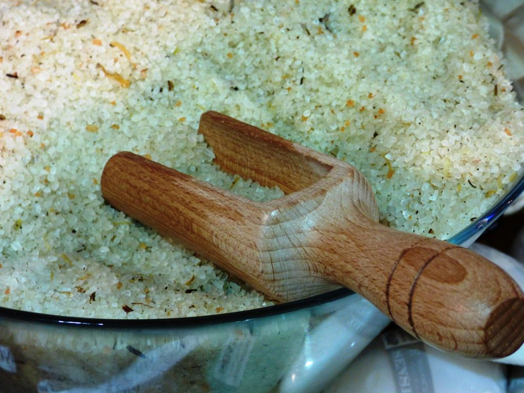 salts for a hot bath, in ceramic bowl with wooden scoop