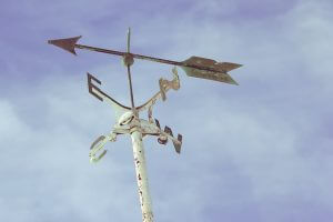 weathervane in a clear sky to show setting an improvement goal