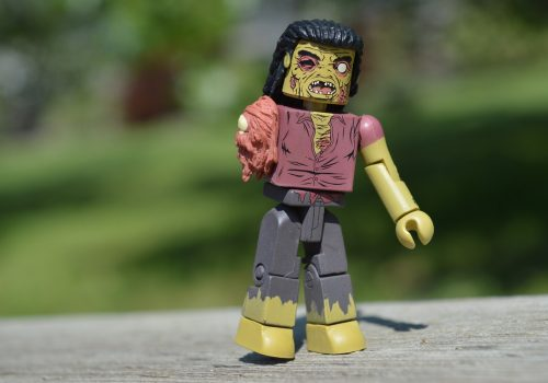 Lego zombie character in natural setting, representing zombie apps