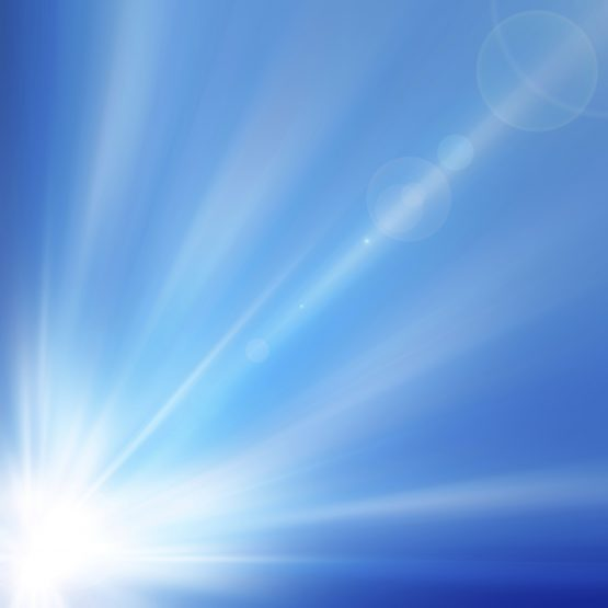Abstract blue background with diffused beam of light