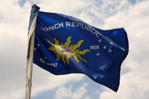 blue flag of Conch Republic micronation with yellow sun and white stars