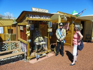 Republic of Molossia micronation trading company with Kevin Baugh and guest standing outside the shack