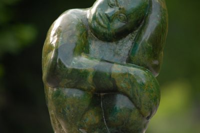 Verdite stone sculpture titled Boy Dreaming by one of Zimbabwean stone artists, Sylvester Mubayi