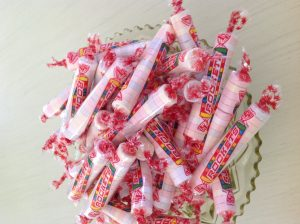 rolls of candy called Rockets in a dish