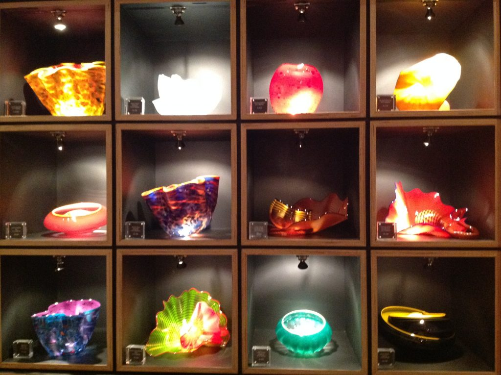 4x3 grid cabinet of Chihuly glass bowls for sale