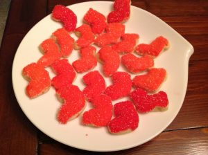 decorated sugar cookies in shape of small red Christmas stockings