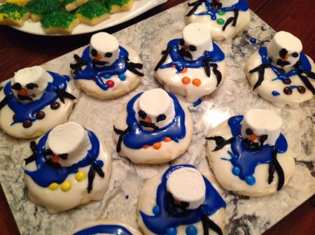 sugar cookies with marshmallow melting snowman on top