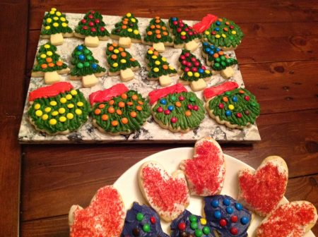 decorated sugar cookies with buttercream icing - wreaths, trees, mittens, bells