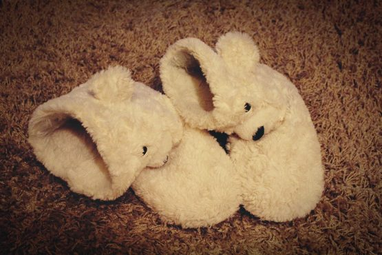 pair of fuzzy white bear slippers