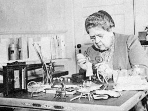 Frances Glessner Lee working on miniatures for her Nutshell Studies
