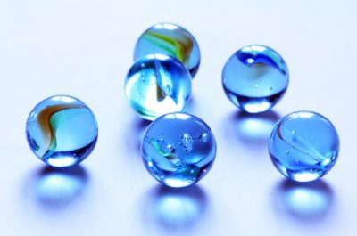 six blue glass marbles