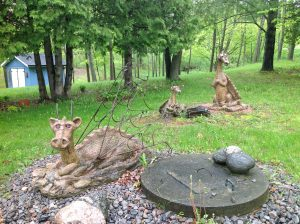 three stone dragons in yard