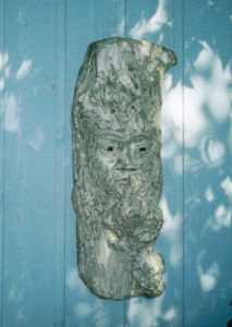 stone sculpture ape with finger to lips