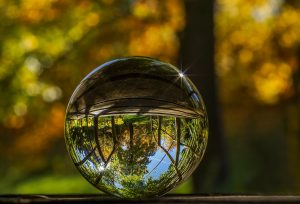 glass ball with upside down reflection of natural outdoor scene