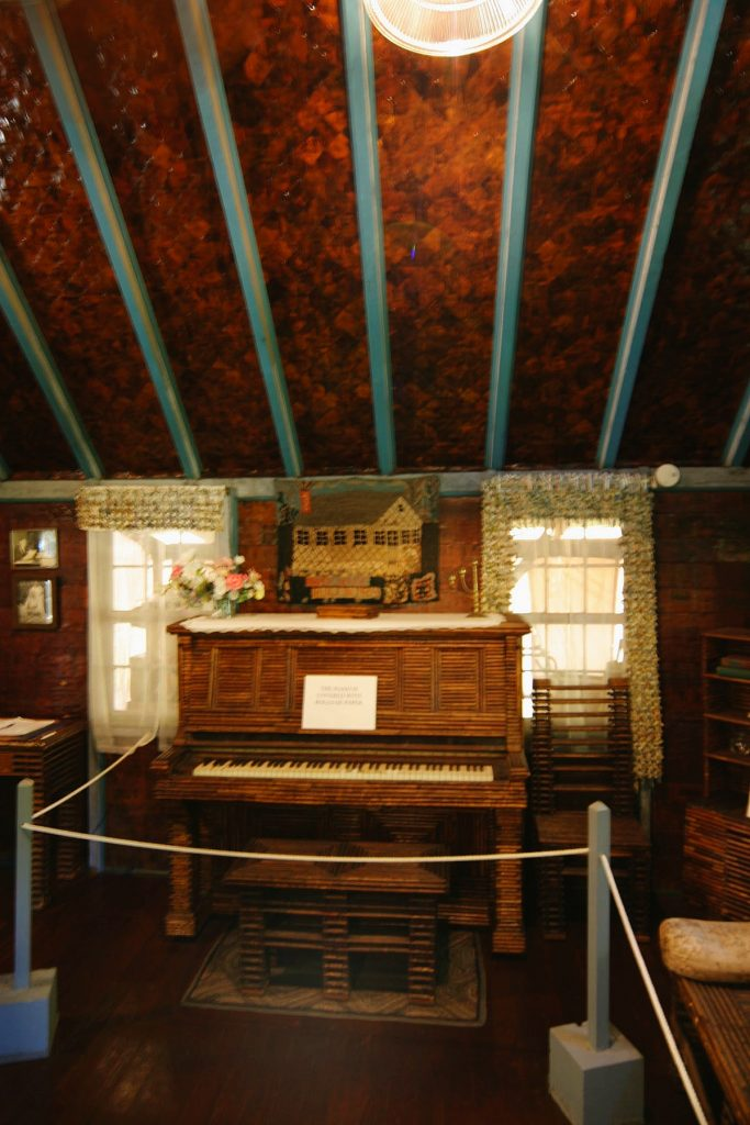 paper covered piano in paper house Rockport