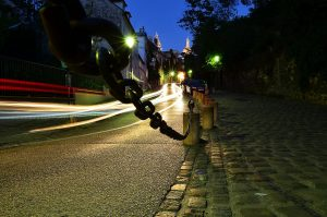 chain roping off cobblestones on Paris night