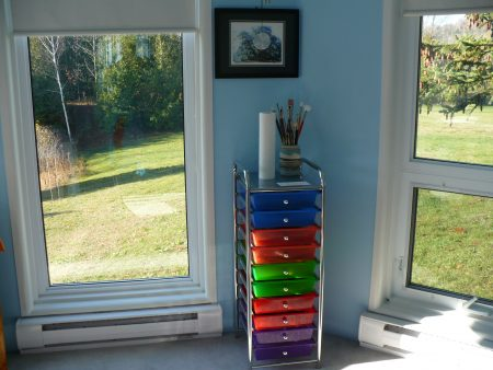 multi-coloured set of drawers in art studio