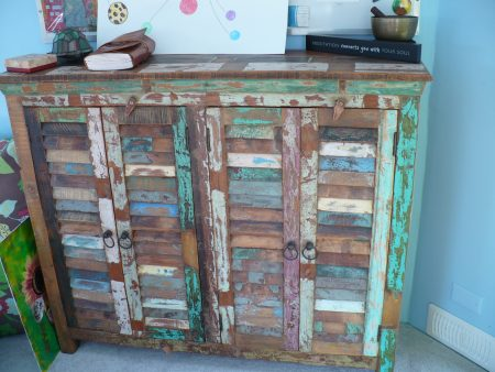 painted wooden cabinet with shutter doors