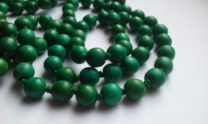 necklace of identical green plastic beads