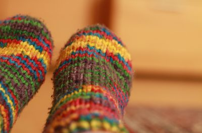 colourful knitted wool socks on feet