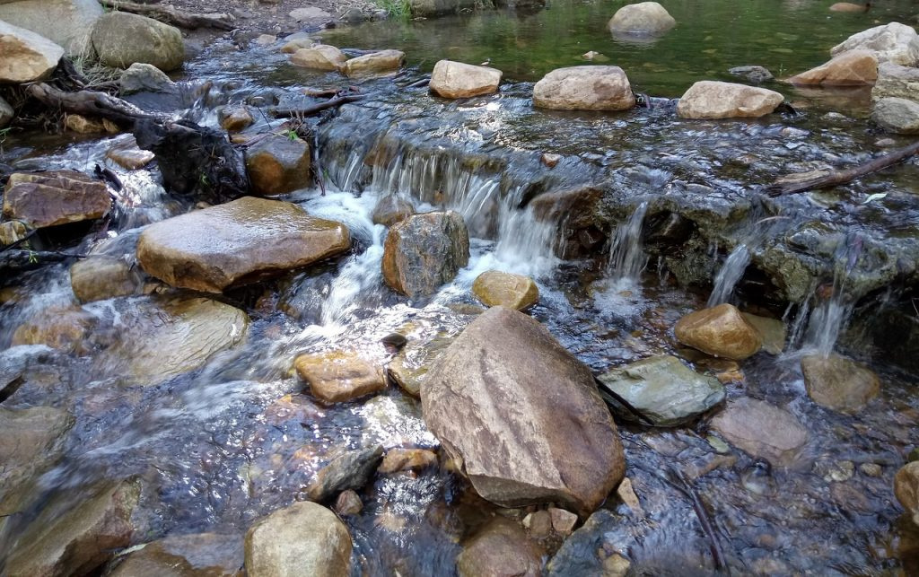 creek, small waterfall, many rocks