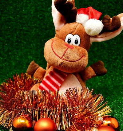 stuffed toy reindeer with tinsel and gold balls
