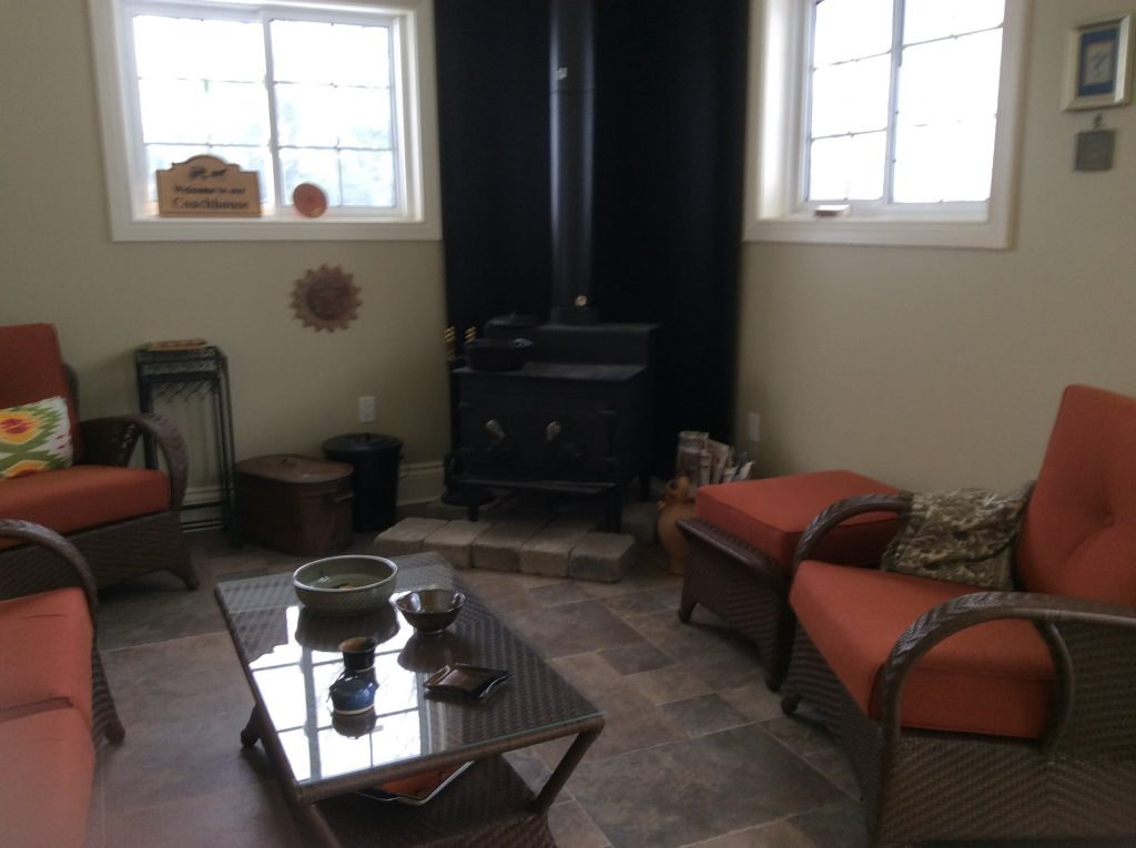 woodstove and furniture in coachhouse