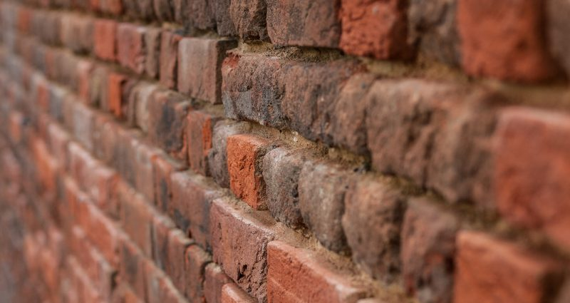 side angle view of red brick wall