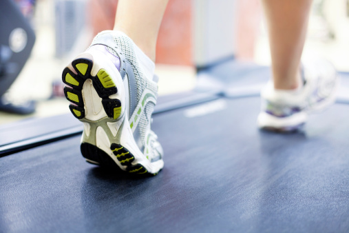woman's feet on treadmill
