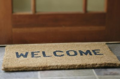 welcome mat at door of house