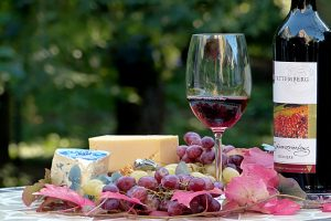 grapes, cheese, wine against tree background