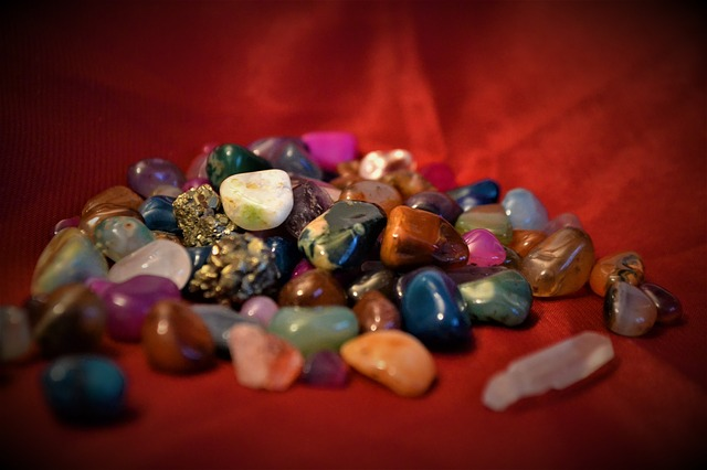 crystals and stones on red background