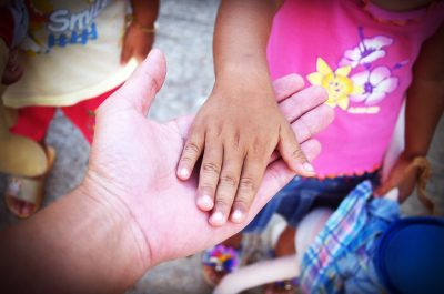 give forward to next generation elderly hand and child's hand