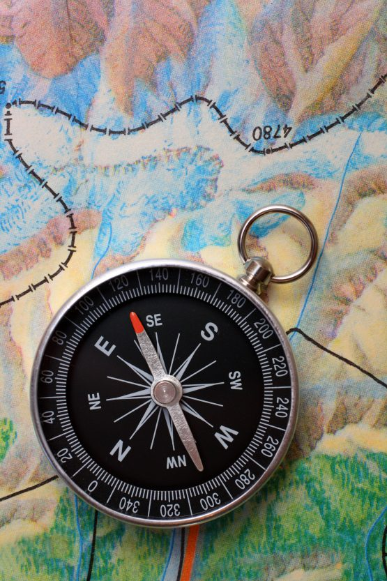 compass against colourful contour map