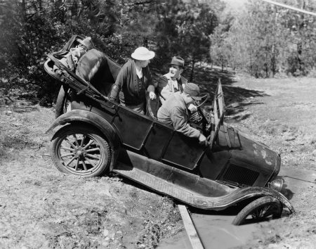 black and white old image of model T stuck in mud