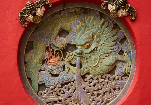 Chinese dragon symbol on red background